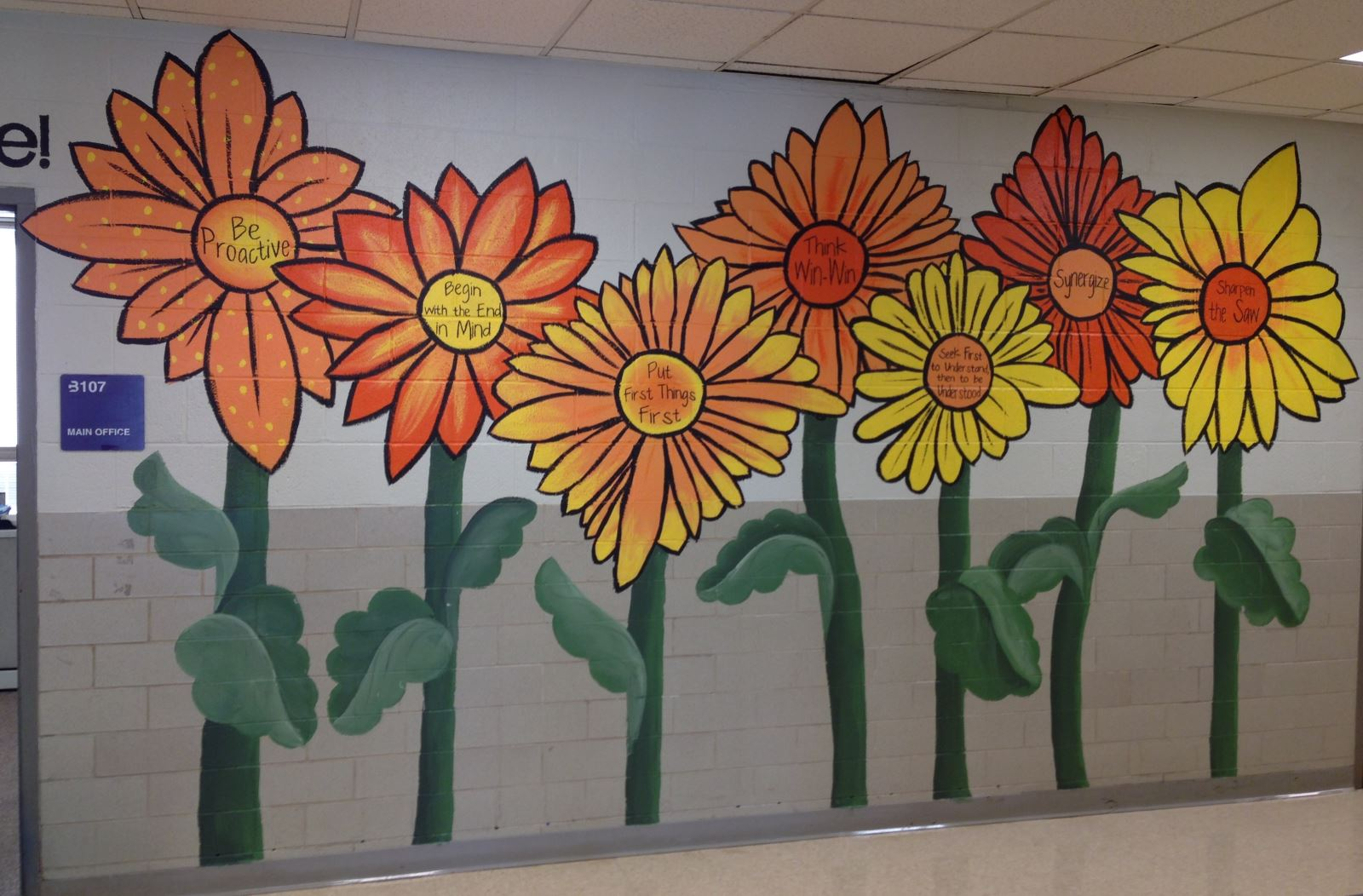 Flowers painted with the 7 Habits on the hallway wall