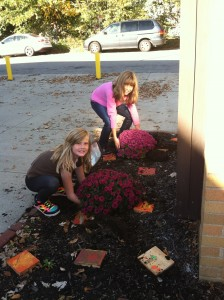 photo of students outside planting mums