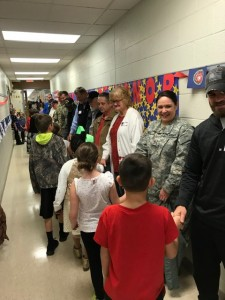 Students shaking hands with Veterans