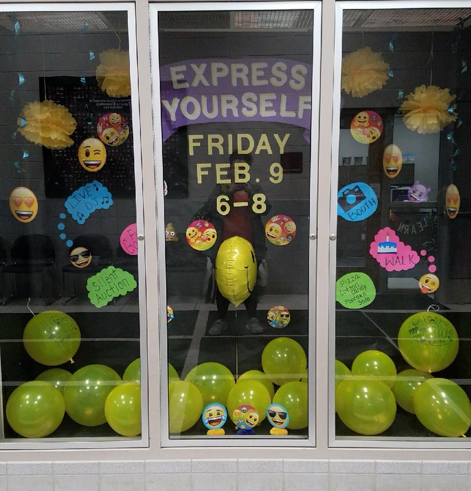 Parent Teacher Organization display case promoting the express yourself, emoji themed dance, on Friday, February nine from six to eight pm.