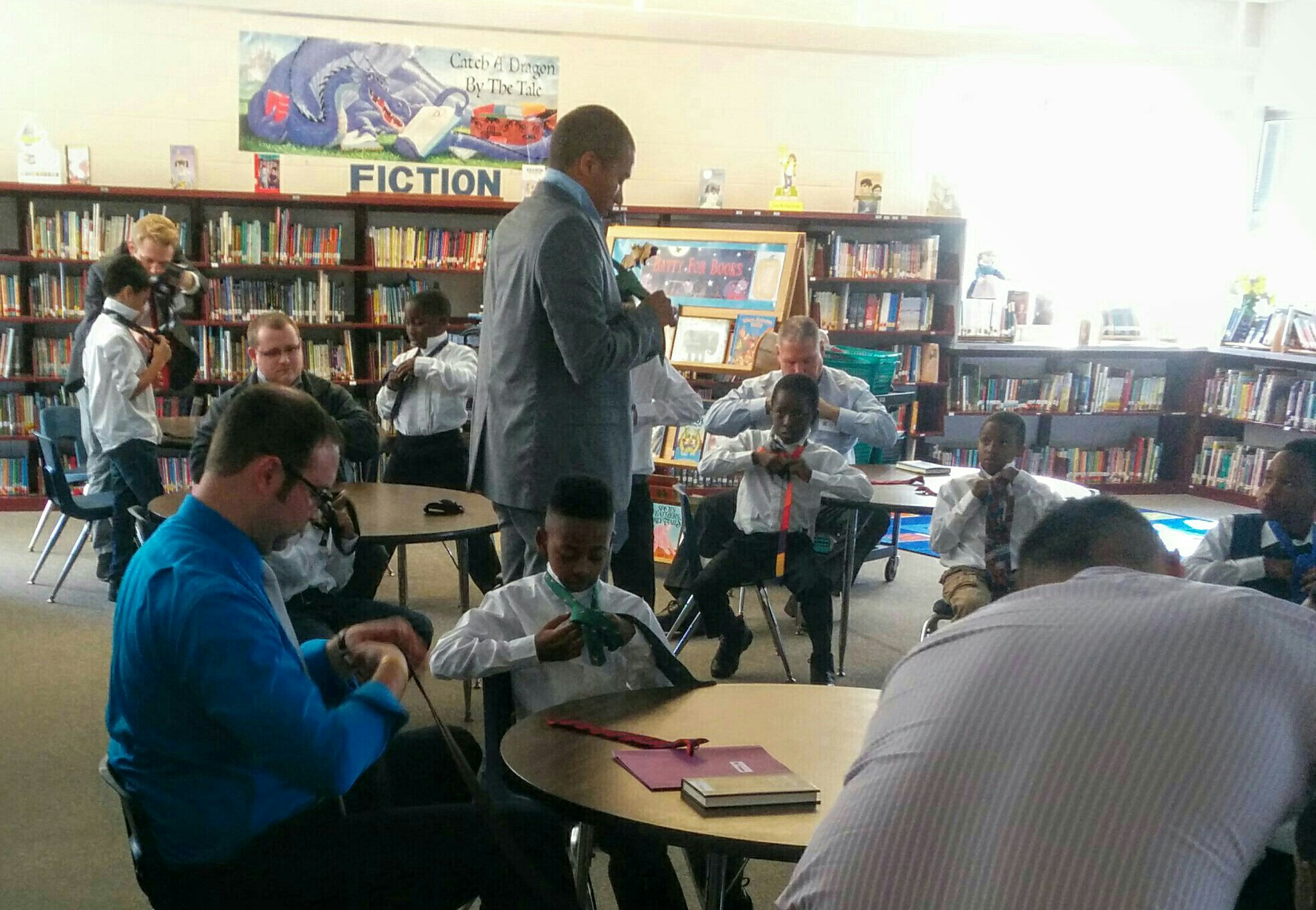 Picture of students in the Young Gents program learning to tie a necktie.