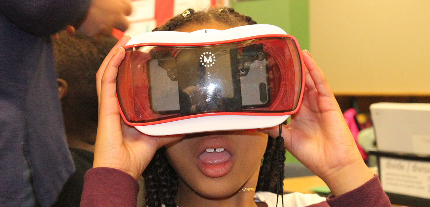 Tussing Elementary Student looking in virtual reality glasses