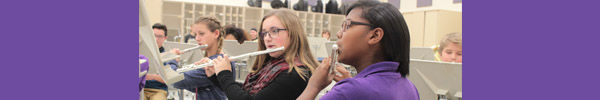 Image of girls playing flutes