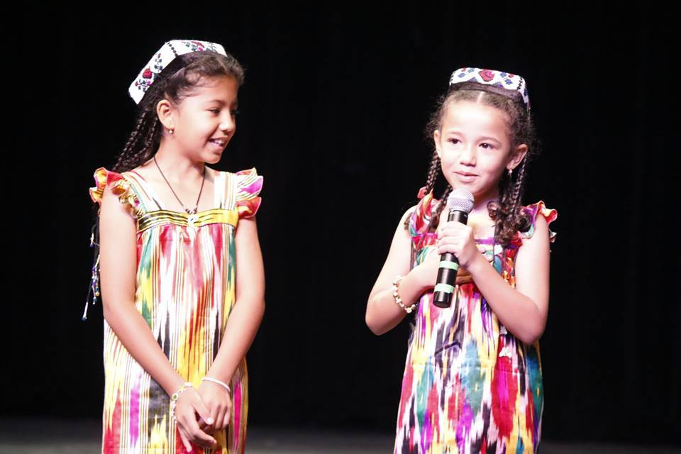 Photo showing sisters performing on stage at the 2016 commUNITY Fair.