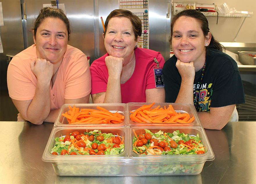 Heritage Elementary School cooks prepare to serve healthy lunches to students