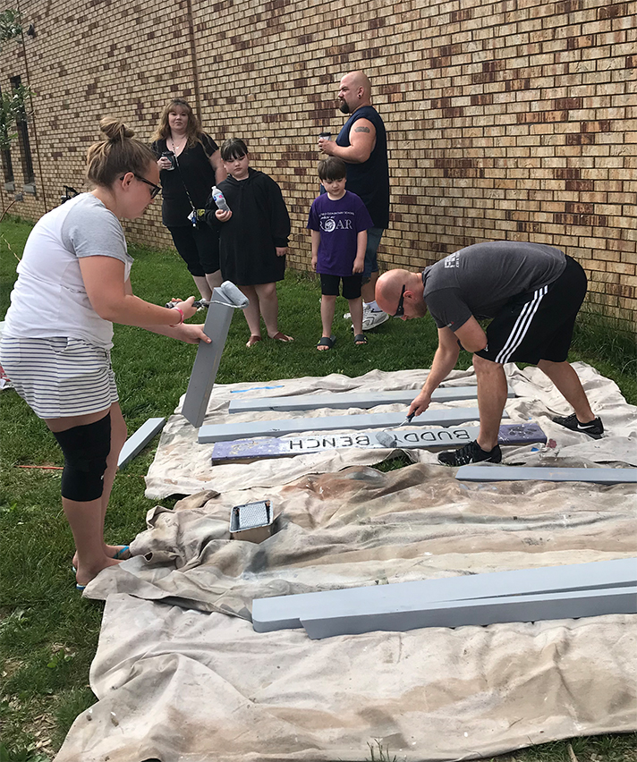 Volunteers rebuild the buddy bench