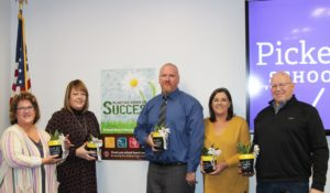 School Board Members holding potted plants image