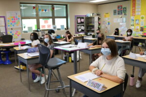 Kids in masks in class image